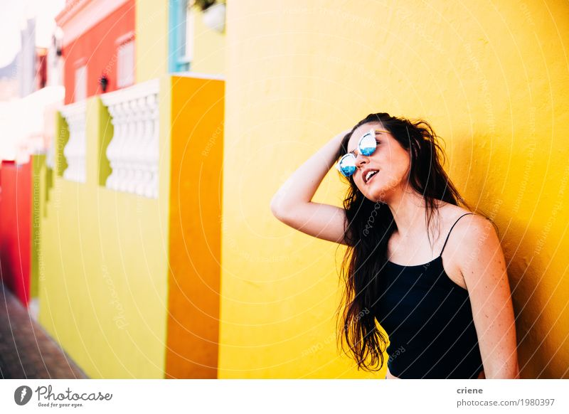 Portrait of caucasian women standing in front of yellow wall Woman Youth (Young adults) Summer Young woman Colour House (Residential Structure) Adults Yellow Lifestyle Feminine Happy Bright Copy Space Fresh Esthetic Stand