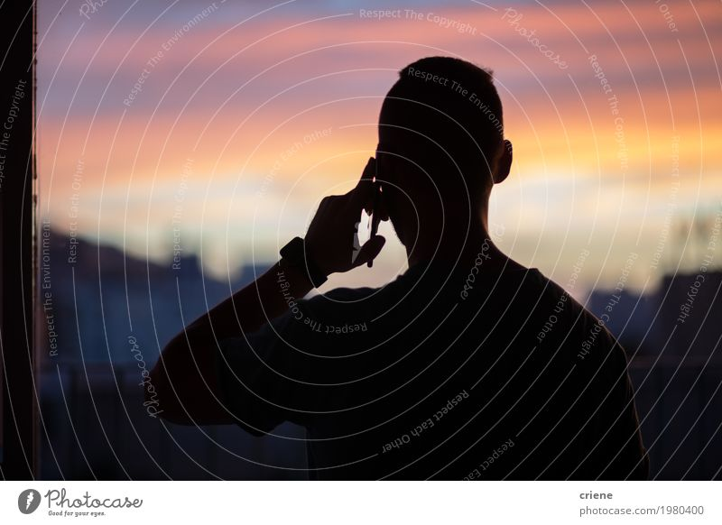 Silhouette of young man on the phone Youth (Young adults) Man Young man Adults To talk Business Masculine Technology Telecommunications Telephone Cellphone Meeting PDA Businessman To call someone (telephone) Entertainment electronics