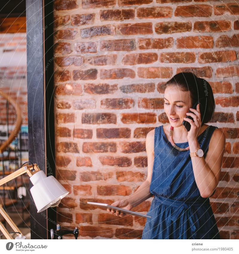 Young businesswoman receiving phone call in office Human being Youth (Young adults) Young woman Adults To talk Lifestyle Feminine Business Work and employment