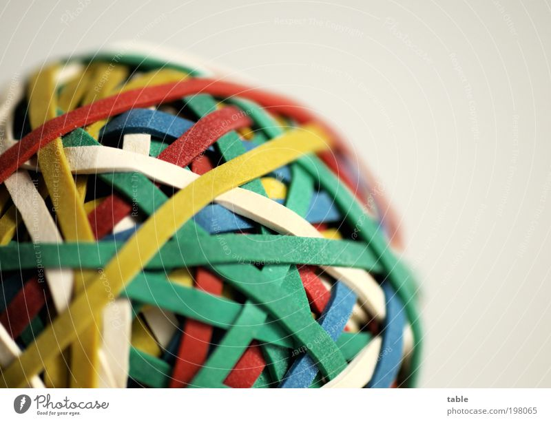 Give me some gum. . . . Work and employment Office work Packaging Rubber Elastic band rubber gun Plastic Sphere Network Round Blue Multicoloured Yellow Green