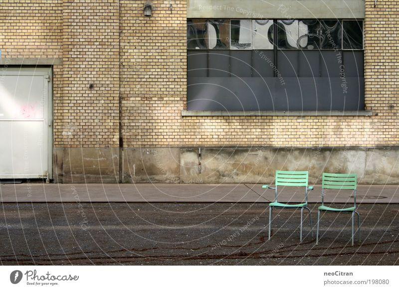 Even more chairs Chair Winterthur Places Parking garage Window Door Asphalt Chain Metal Plastic Stand Gray Green Symmetry Esthetic Arrangement Colour photo