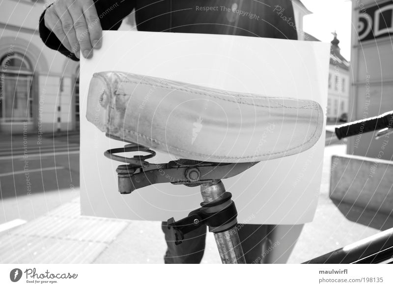 street furniture Bicycle Life 1 Human being Sun Sunlight Graz Small Town Means of transport Traffic infrastructure Paper Piece of paper Sit Stand Old Retro Soft