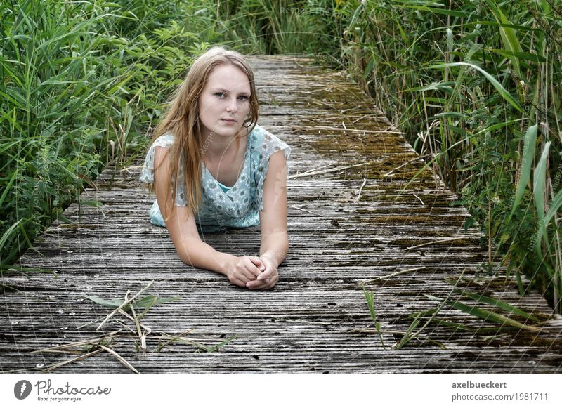 blonde young woman lying on a wooden walkway Lifestyle Leisure and hobbies Human being Feminine Young woman Youth (Young adults) Woman Adults 1 18 - 30 years