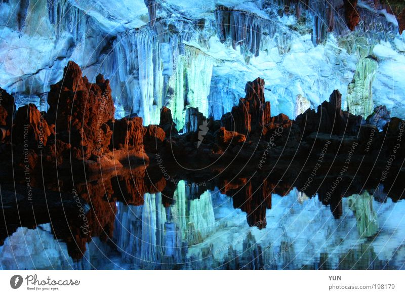 cave imaging Tourism Work of art Elements Lake Cave Tourist Attraction Stone Esthetic Blue Brown reed flute cave China Guilin stalagmite Stalactite