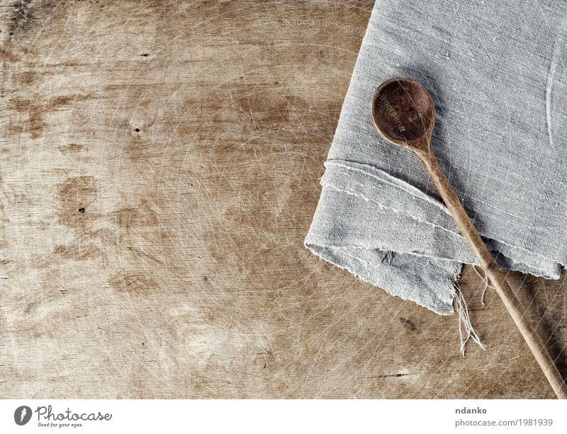 Brown wooden background with a wooden spoon Spoon Table Kitchen Wood Old Above Gray cook board empty space Shabby housewares Home textile napkin Tablecloth