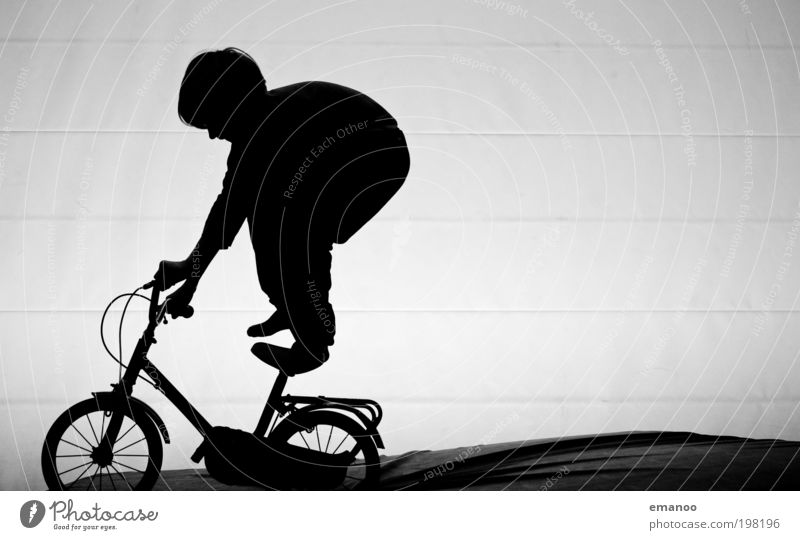 Human being Child Joy Black Playing Freedom Boy (child) Movement Infancy Contentment Bicycle Leisure and hobbies Crazy Stand Driving To hold on
