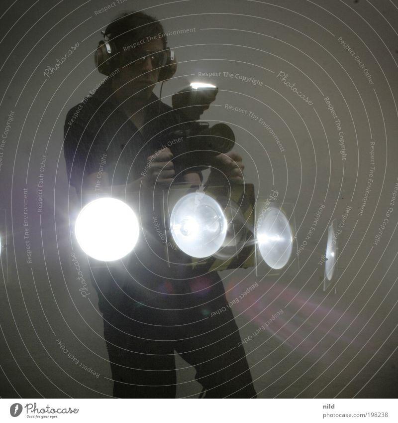 The photo machine Lifestyle Joy Leisure and hobbies stroboscope lightning bolt Camera Machinery man-machine Technology Masculine Young man Youth (Young adults)