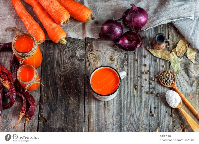 Carrot juice in glass jars and iron mug Food Vegetable Herbs and spices Vegetarian diet Diet Beverage Drinking Hot drink Juice Cup Table Wood Old Fresh Above