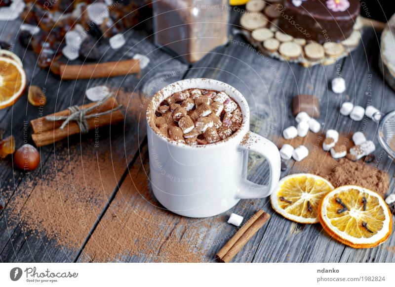 Cocoa with marshmallows is sprinkled with chocolate Natural Wood Gray Brown Above Orange Fruit Fresh Table Beverage Drinking Candy Hot Dessert Cup Top