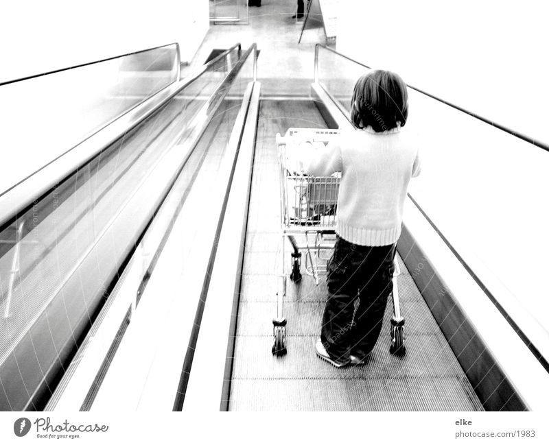 Purchasing sequence 1 Escalator Shopping Trolley Child Push Supermarket Human being Consumption Black & white photo