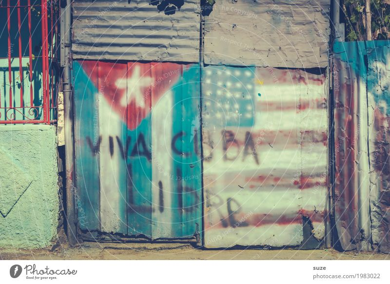 Genuine Cuba Freedom City trip Culture Warmth Outskirts Hut Gate Sign Graffiti Flag Old Poverty Dirty Broken Rebellious Retro Pride Decline Past Transience