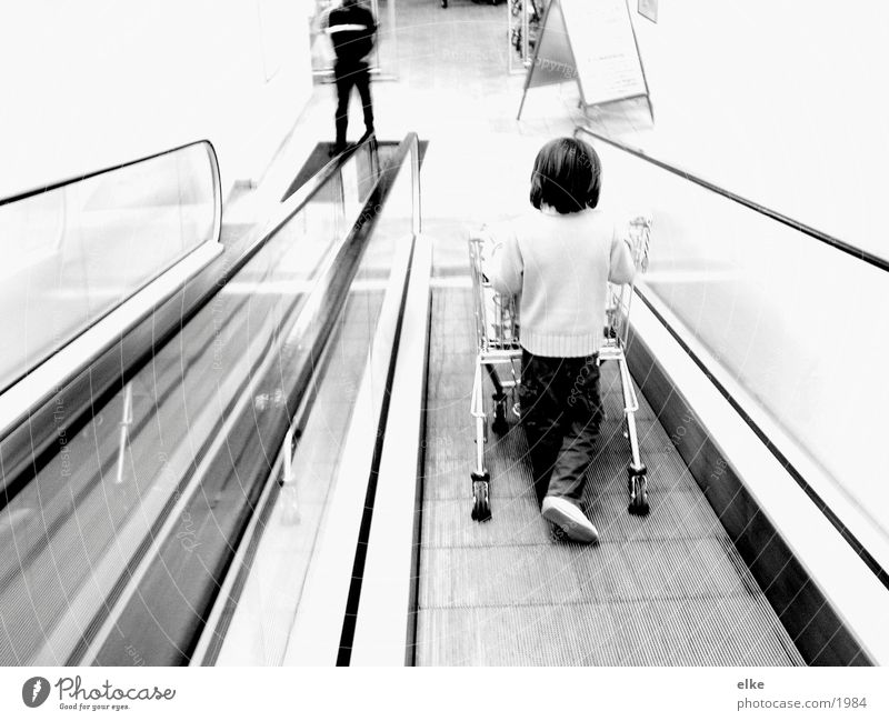 purchase sequence Escalator Shopping Trolley Child Push Supermarket Human being Black & white photo
