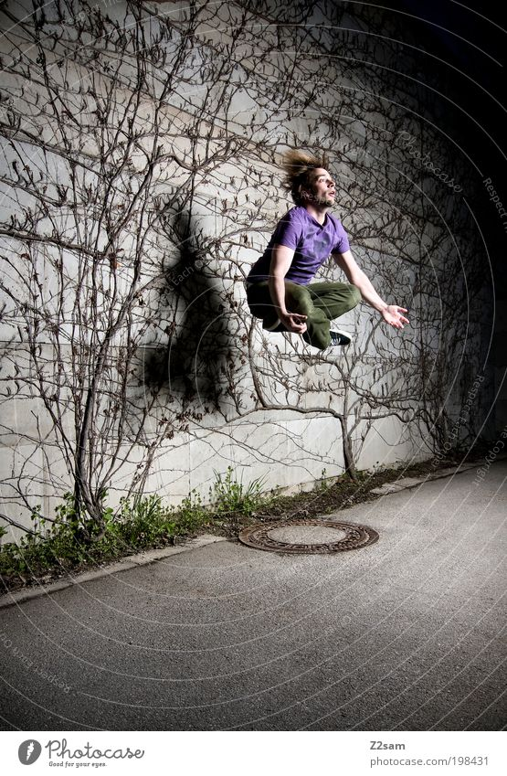 Human being Youth (Young adults) Tree Plant Dark Jump Style Hair and hairstyles Gray Landscape Power Adults Flying Crazy Might Bushes