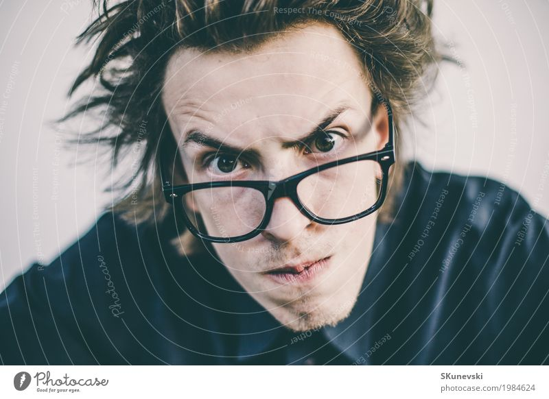 Young nerd with glasses portrait Joy Leisure and hobbies Playing Entertainment Technology Human being Man Adults Hand Fingers Old Observe Funny Retro Crazy Red