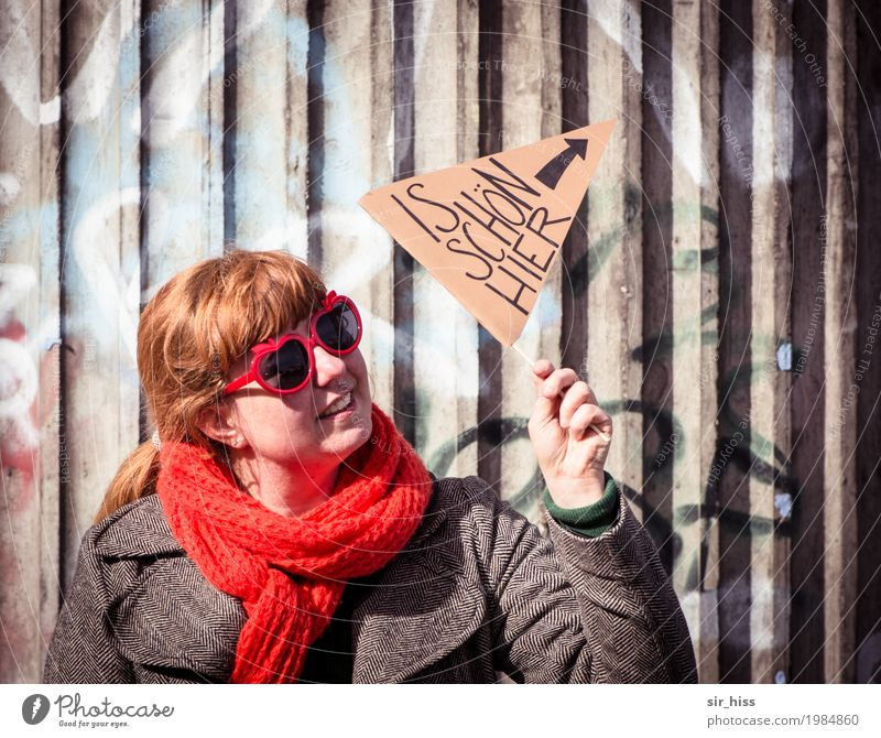 "Hamburg - ""Is beautiful here"" Human being Woman Adults 1 Bridge Wall (barrier) Wall (building) Overpass Coat Sunglasses Scarf Sign Characters Signs and labeling"