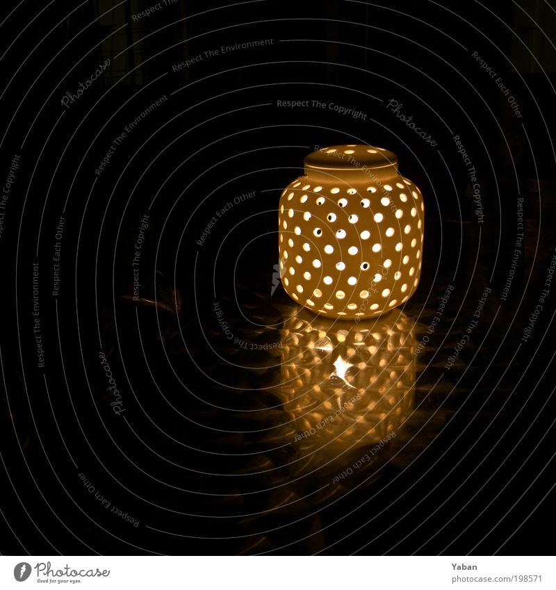There is a light ... Design Living or residing Decoration Lamp Balcony Candle Illuminate Round Warmth Contentment Night shot Night life Dark Colour photo
