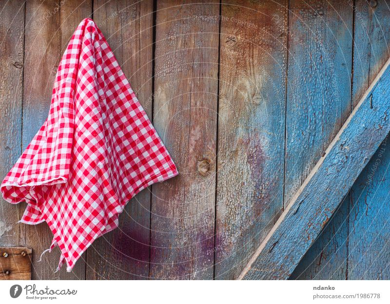 Red cloth in a cell hanging on a wooden cracked wall Old Blue White Wood Design Kitchen Cloth Material Crack & Rip & Tear Surface Tablecloth Consistency Menu