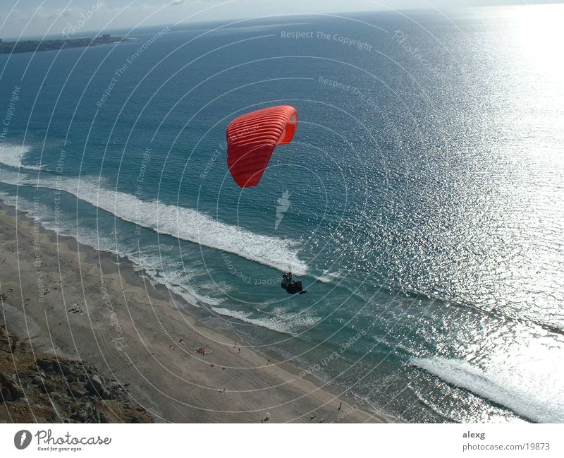 Paragliding on the cliff to the sea Paraglider Beach Cliff Ocean Sports Flying