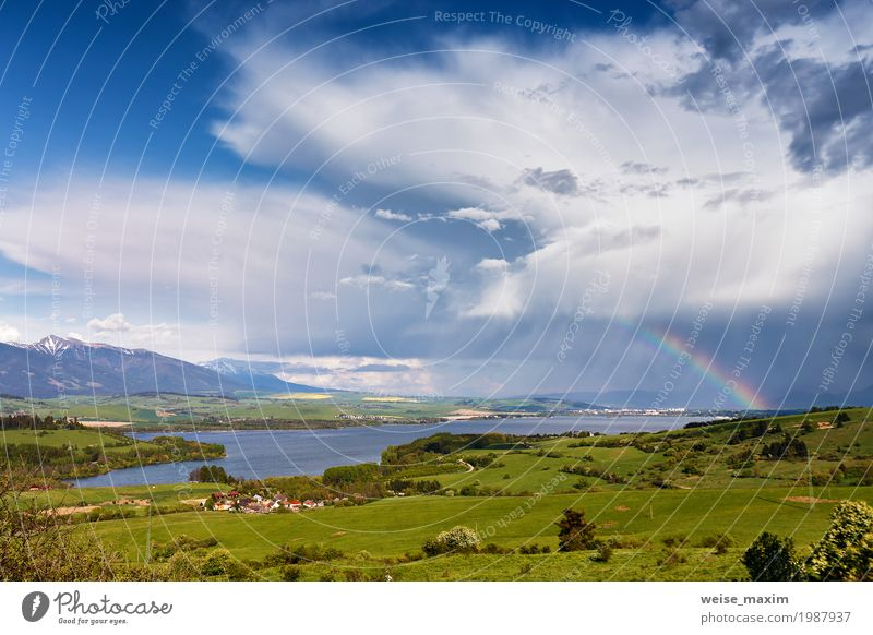 Rainbow after rain. Spring rain and storm in mountains Sky Nature Vacation & Travel Plant Summer Town Green Tree Landscape Clouds Far-off places Forest Mountain