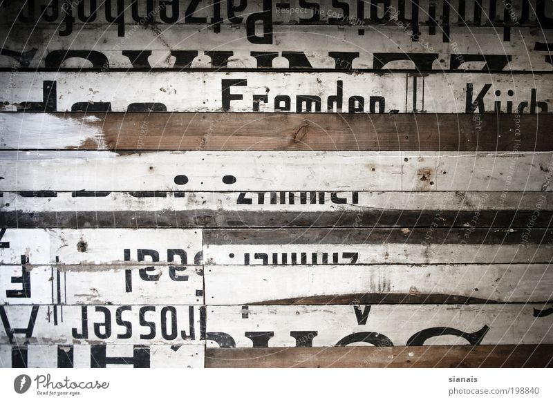 patchwork Wall (barrier) Wall (building) Wood Characters Signs and labeling Decline Past Transience Change Typography Wooden board Old Repaired Barrier