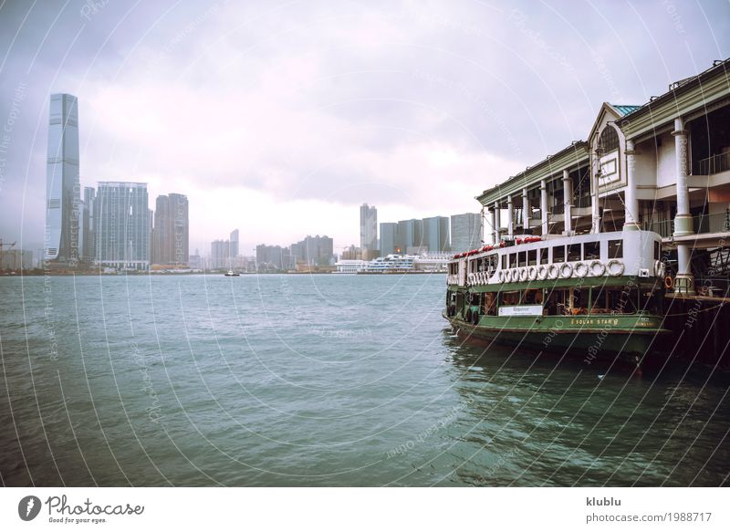 A boat station and cityscape in Hong Kong Life Vacation & Travel Tourism Trip Landscape Downtown High-rise Building Architecture Ferry Watercraft Sail Movement