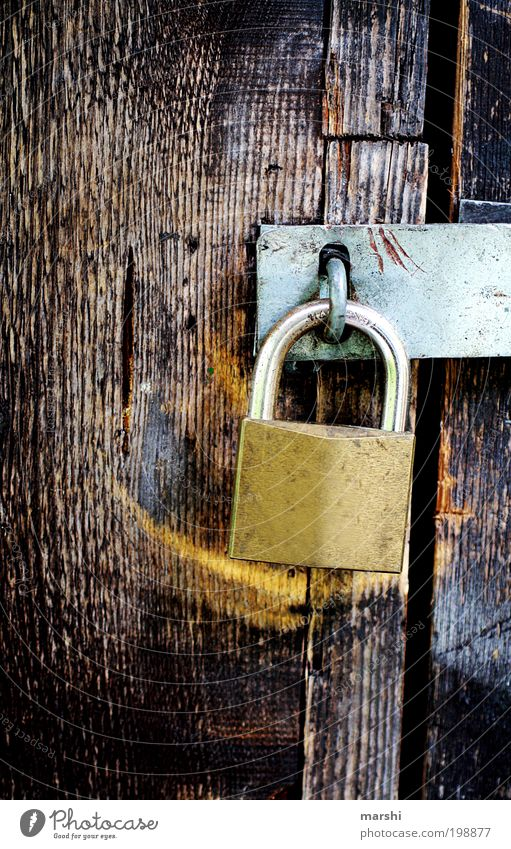 Closed Wood Old Lock Mysterious Confine Texture of wood Locking bar Padlock Metal Captured Key service Colour photo Exterior shot Contrast