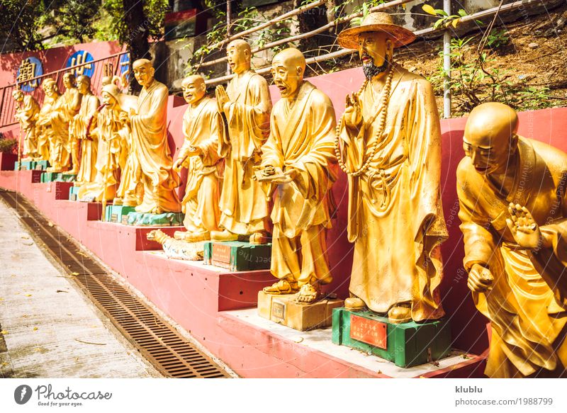 golden statues in 1000 Buddhas Temple in Hong Kong. Vacation & Travel Beautiful Face Architecture Religion and faith Street Yellow Lanes & trails Art Exceptional Tourism Bright Decoration Gold Culture Symbols and metaphors