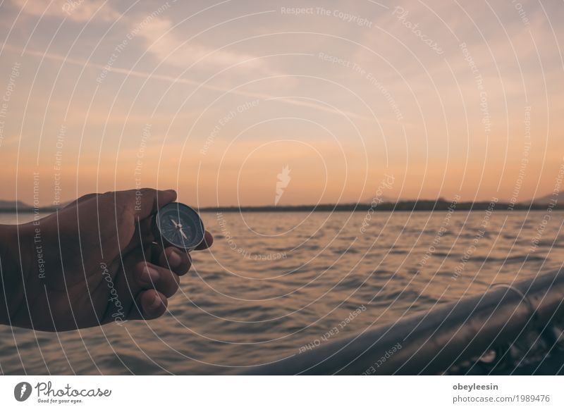 Hand with compass at beach at sunset sky Human being Nature Landscape Ocean Beach Adults Art Waves Adventure Bay Artist 30 - 45 years