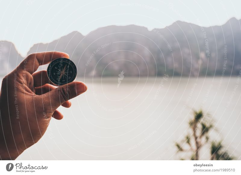 Hand with compass at mountain road at sunset sky Human being Nature Landscape Hand Adults Lifestyle Style Art Adventure 30 - 45 years