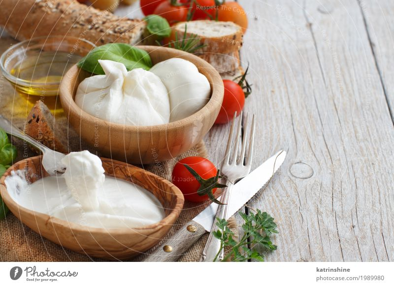 Italian cheese burrata with bread, vegetables and herbs Cheese Vegetable Bread Herbs and spices Cooking oil Nutrition Vegetarian diet Italian Food Bowl Fork