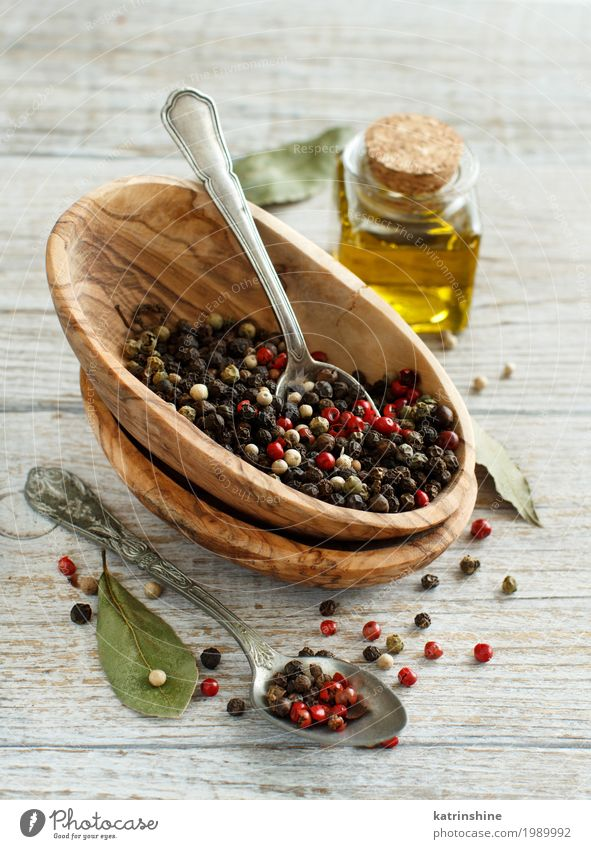 Peppercorn mix in a bowl, bay leaves and olive oil Herbs and spices Cooking oil Bowl Bottle Spoon Kitchen Green Red Black Aromatic asian border cook flavor food
