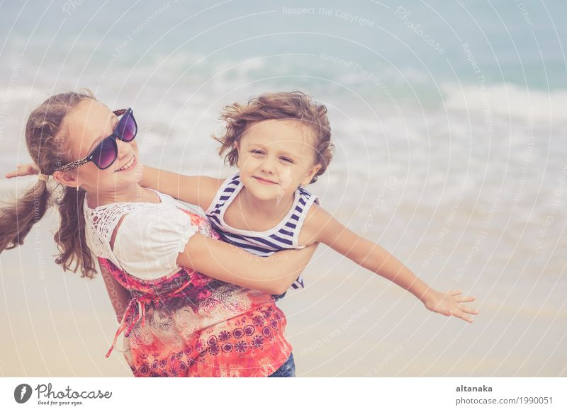 Sister and brother playing on the beach at the day time. Concept Brother And Sister Together Forever Lifestyle Joy Happy Beautiful Relaxation