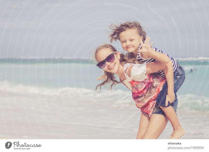 Sister and brother playing on the beach at the day time. Lifestyle Joy Happy Beautiful Relaxation Leisure and hobbies Playing Vacation & Travel Freedom Summer