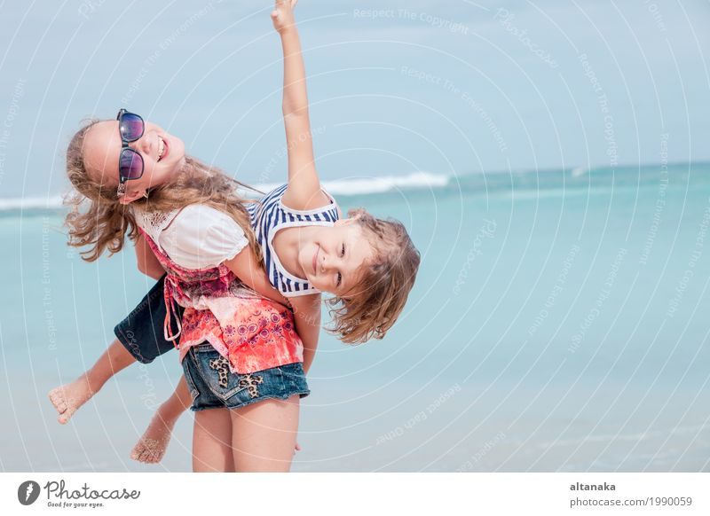 Sister and brother playing on the beach at the day time. Human being Child Nature Vacation & Travel Summer Beautiful Sun Hand Ocean Relaxation Joy Girl Beach