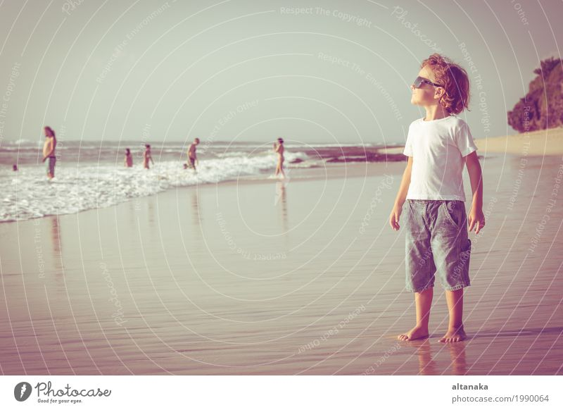 Happy little boy playing on the beach Human being Child Sky Nature Vacation & Travel Man Summer Sun Hand Ocean Relaxation Joy Beach Adults Lifestyle Emotions