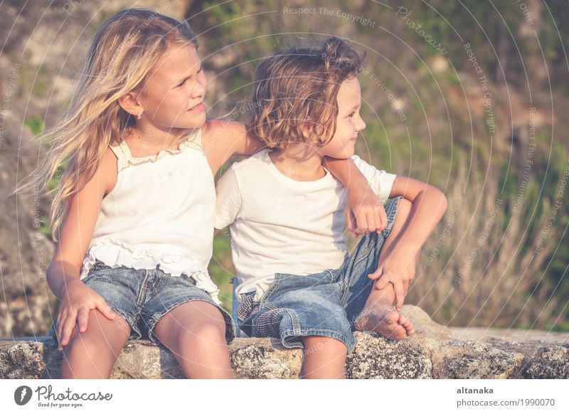 Sister and brother playing on the beach at the day time. Human being Child Nature Vacation & Travel Summer Beautiful Sun Hand Ocean Relaxation Joy Girl Beach Lifestyle Emotions Family & Relations