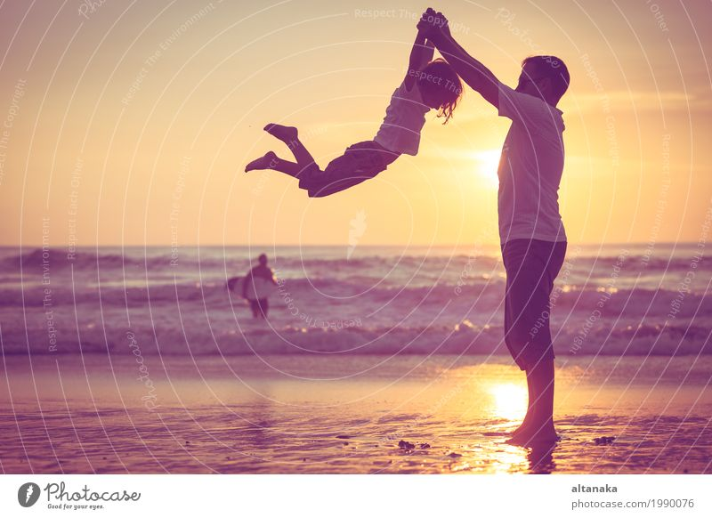 Father and son playing on the beach at the sunset time. Child Nature Vacation & Travel Man Summer Sun Ocean Joy Beach Adults Lifestyle Love Sports Boy (child) Family & Relations Small