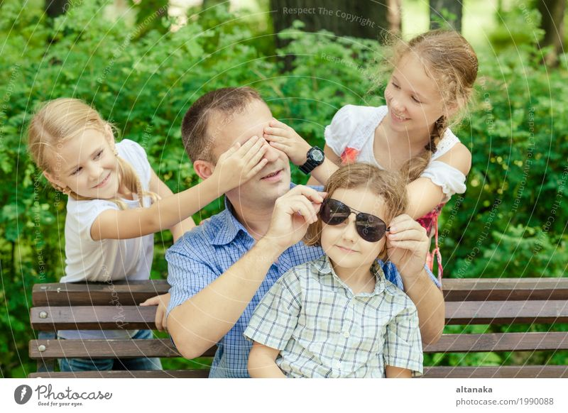 Father and children playing at the park at the day time. Human being Child Nature Vacation & Travel Man Summer Sun Joy Girl Adults Life Lifestyle Love