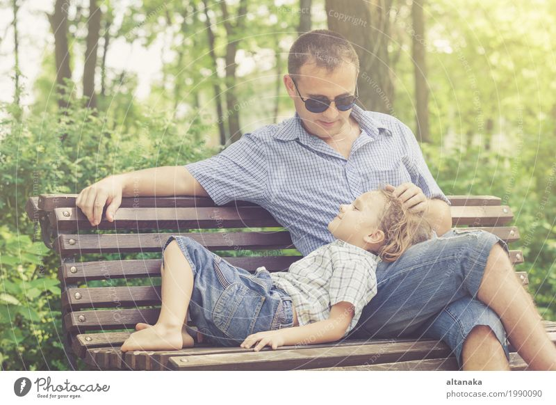 Father and son playing at the park on bench at the day time. Human being Child Nature Vacation & Travel Man Summer Sun Joy Adults Life Lifestyle Love