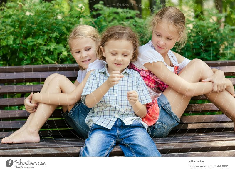 Three happy children playing in the park at the day time. Concept Brother And Sister Together Forever Lifestyle Joy Happy Beautiful Face Leisure and hobbies