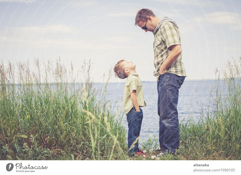 Father and son playing at the park near lake at the day time. Child Nature Vacation & Travel Summer Sun Relaxation Joy Beach Adults Life Lifestyle Love Emotions