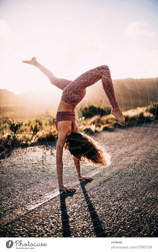 Young caucasian woman doing yoga on road in sunset Woman Youth (Young adults) Summer Young woman Sun Joy Adults Warmth Street Life Lifestyle Sports Feminine Happy Leisure and hobbies Trip
