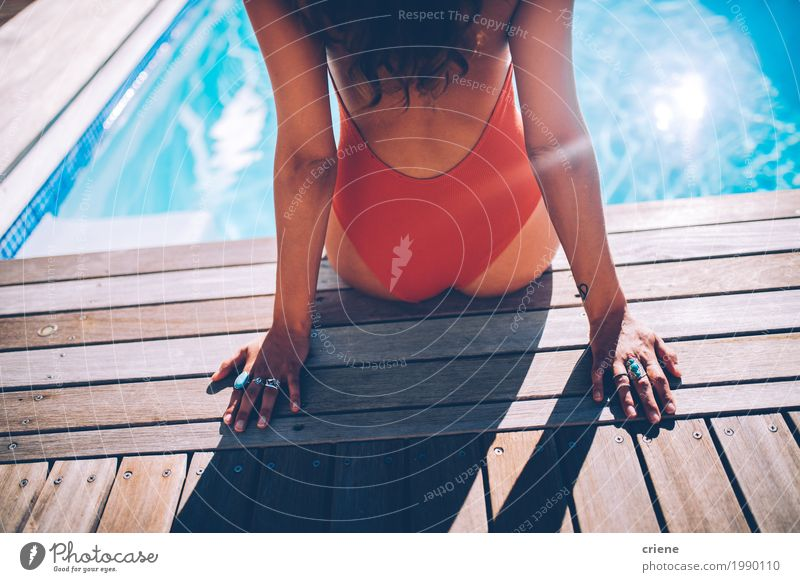 Back view of woman sitting at swimming pool in swimwear Human being Woman Vacation & Travel Youth (Young adults) Summer Young woman Beautiful Eroticism