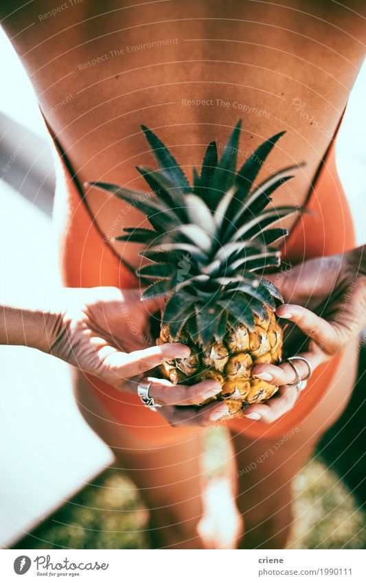 Close-up of woman holding pineapple behind her back Fruit Lifestyle Joy Swimming pool Swimming & Bathing Summer Summer vacation Sun Sunbathing Garden