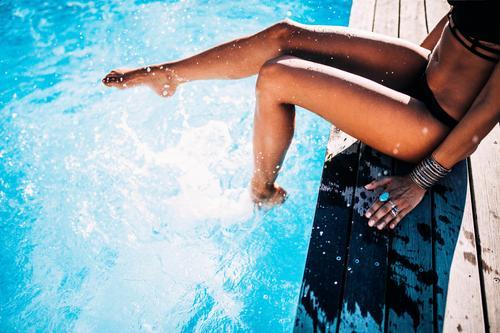 Close-up of woman having fun in swimming pool Lifestyle Joy Wellness Swimming pool Swimming & Bathing Vacation & Travel Summer Summer vacation Sun Sunbathing