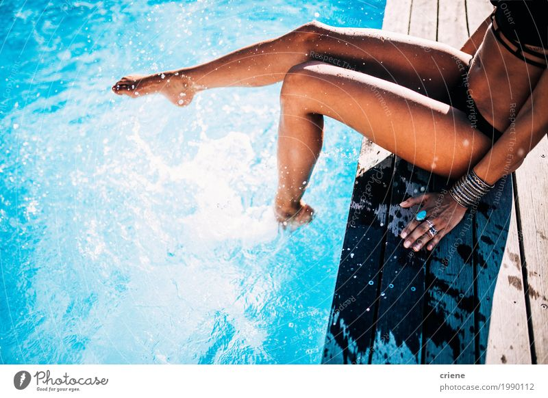 Close-up of woman having fun in swimming pool Woman Vacation & Travel Youth (Young adults) Blue Summer Young woman Colour Sun Joy Adults Life Lifestyle Swimming & Bathing Leisure and hobbies Fresh Sit