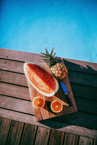 Delicious fruit platter with pineapple, watermelon and oranges Food Fruit Orange Nutrition Eating Crockery Knives Lifestyle Healthy Eating Well-being