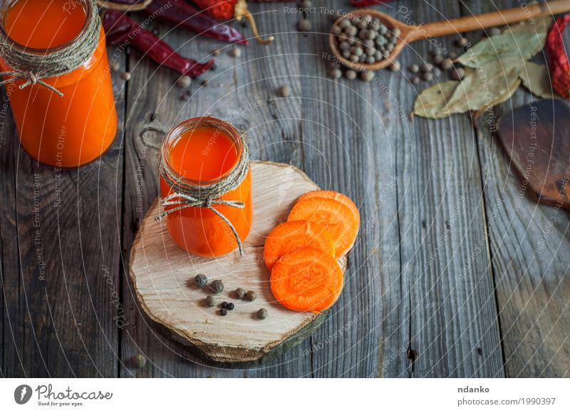 Glass jars with juice on a gray wooden background Nature Old Natural Wood Food Gray Orange Fresh Table Herbs and spices Beverage Drinking Vegetable Slice