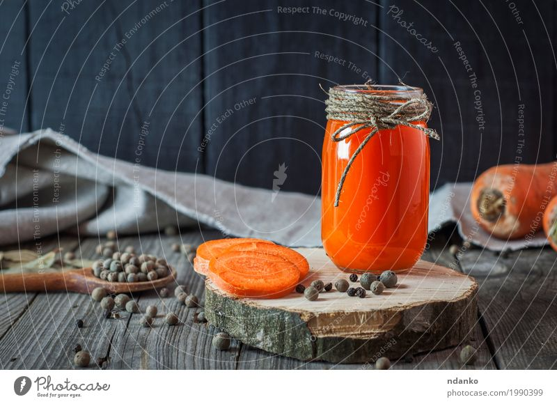 Glass jar with juice on a wooden surface Old Black Natural Wood Food Gray Orange Nutrition Fresh Glass Glass Table Herbs and spices Beverage Drinking Vegetable