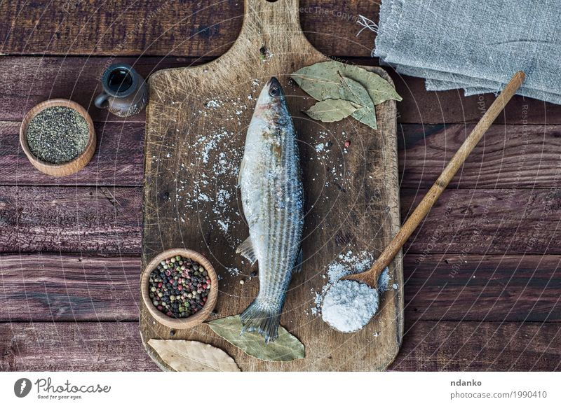 Fresh smelt fish on the kitchen board Food Fish Herbs and spices Eating Spoon Table Kitchen Nature Wood Natural Above Brown White pepper paprika whole salt